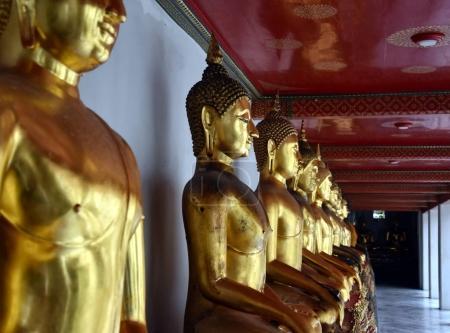 golden Buddha statues in Wat Pho