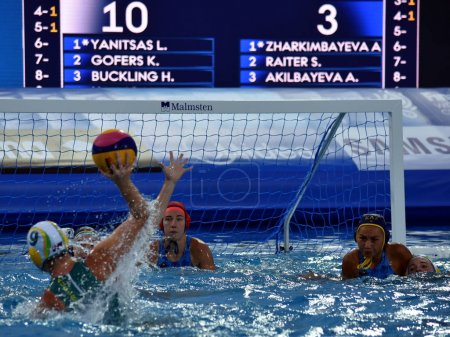 Kazakh women waterpolo team defends against Australia