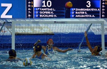 Kazakh women waterpolo team defends against Australia
