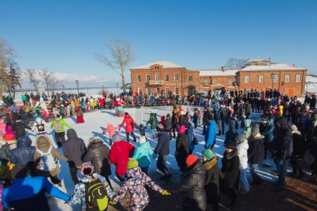 Sviyazhsk, Russia - 26 February 2017: The pancake week - Russian ethnic carnival, Maslenitsa Shrovetide the crowd dances before the burning of winters effigies