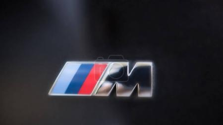 Kazan, Russia - july 2017 - logo sign for BMW M on black hood of the car