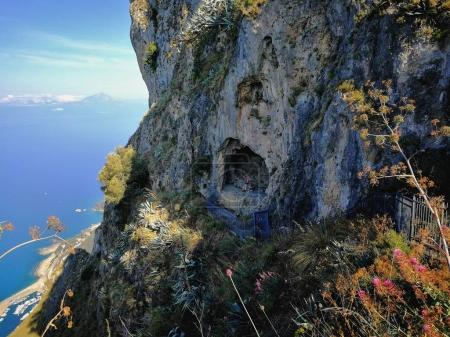 Maratea, Potenza, Basilicata, Italy - June 4, 2017: Panoramic view of the Angel's Cave, under the Statue of Christ the Redeemer, who holds the grave of Count Stefano Rivetti, the businessman of Biella who gave the statue of Christ to the Commune