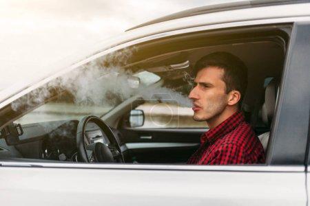 Man smoking while Driving a Car