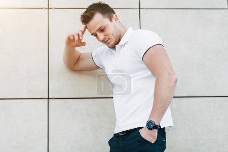 Muscular Man Standing Near the Wall