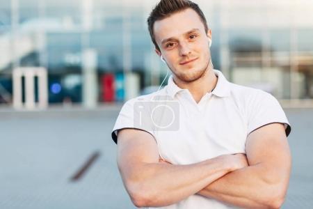 Man Posing on Airport Parking