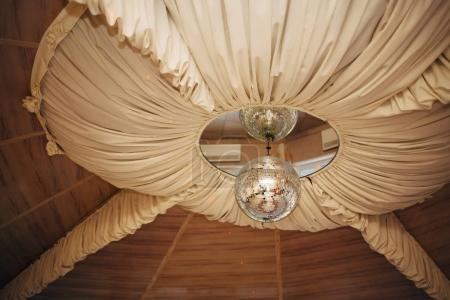 Decorative lamp restaurant on the ceiling. Wedding concept