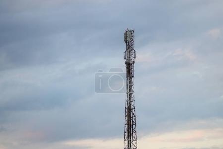 Radio tower on the background of cloudy sky