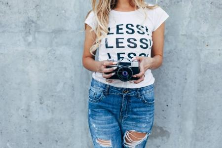 Young woman with film camera
