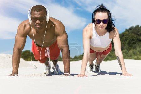athletic couple doing push ups