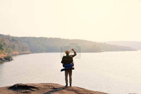 Photo for Happy Asian hipster man backpack in nature background, Relax time on holiday concept travel , color of vintage tone and soft focus - Royalty Free Image