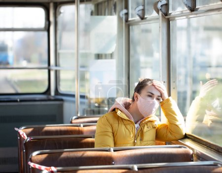 Photo for A young woman in an empty public transport during the pandemic. Coronavirus. - Royalty Free Image