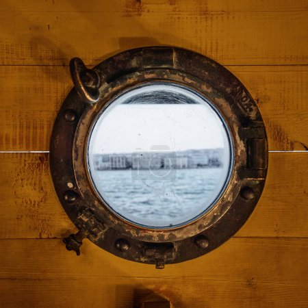 Wooden wall around porthole