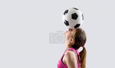 teen girl with a soccer ball