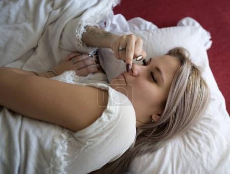 Sleepy  girl shows middle finger