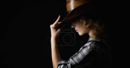 beautiful girl in a cowboy's hat
