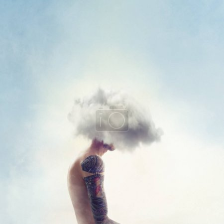 Tattooed man with cloud on head