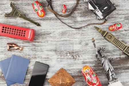 Photo for Travel and tourism background with souvenirs from around the world. View from above - Royalty Free Image