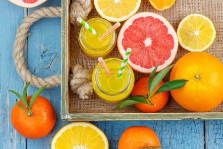 Photo for Different fruits and glass with fresh orange juice, top view - Royalty Free Image