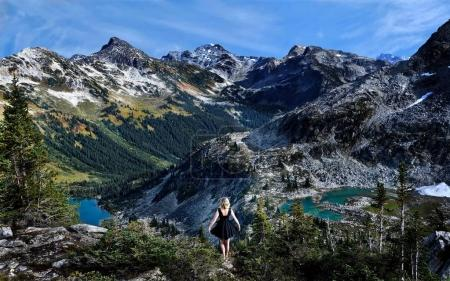 Little black dress and mountains landscape