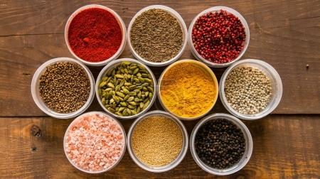 Various colorful spices in plastic containers