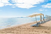 Outdoor with umbrella and chair on beautiful tropical beach and