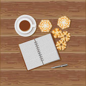 Notepad coffee and Christmas gingerbread Wooden background