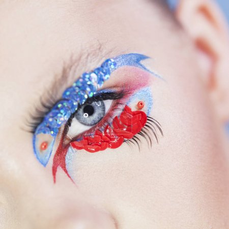 young woman with fish make-up on her eye