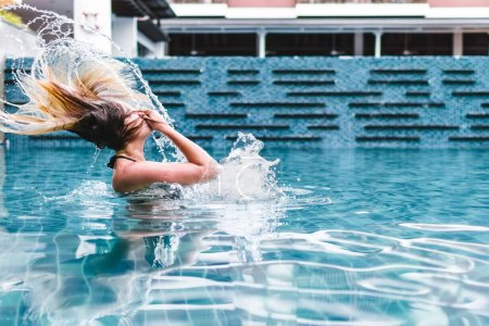 Girl on a Swimming Pool of a Resort