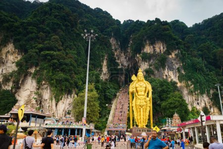 Tourists and Murugan Statue at the batu cave entrance in the north of Kuala Lumpur Malaysia