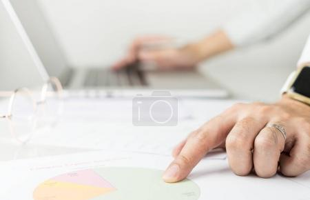 Business man is keying data on to computer