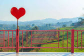 Red heart and pink fence