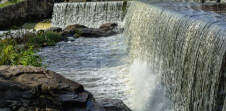 Artificial low waterfall with stones