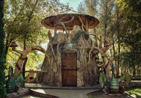 Fairy-tale house in a park with dragons