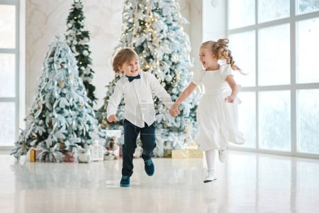 girl with boy holding hands and jumping