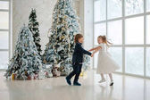 girl with boy holding hands and dancing