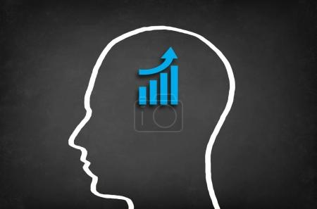 Business success growth chart in head.