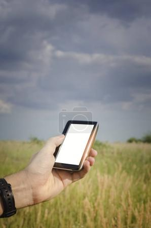 Man navigates with a gps in the hand