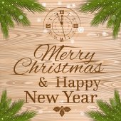 Christmas lettering on a wooden background