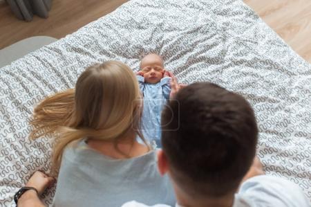 Husband wife and newborn child