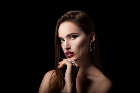 Beauty portrait of girl with jewelry on black background