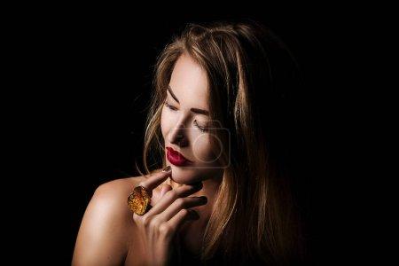 blond girl wearing jewelry
