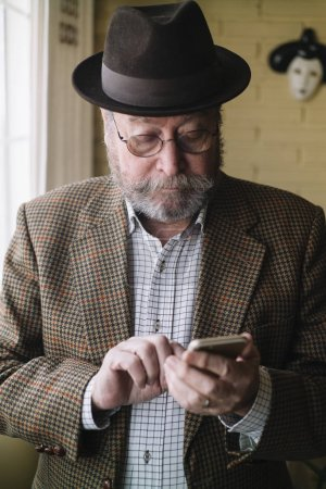 Photo for Man of 72 years old of age with smartphone - Royalty Free Image