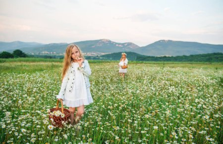 girls with flowers in the field