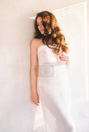young woman standing near the wall