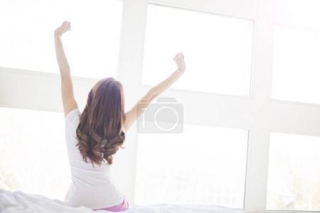 woman near big windows