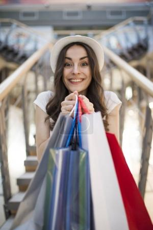 Photo for Happy young woman with shopping bags at mall - Royalty Free Image