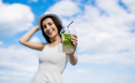 beautiful young woman with mojito
