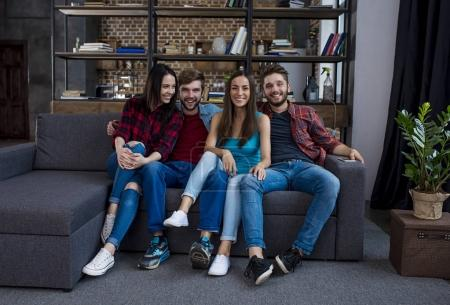young people posing at home