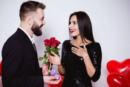 My dear, will you be my wife? A handsome young man asks to become his wife a smiling sweet woman.