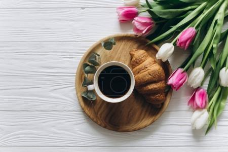 tulips with coffee and croissant